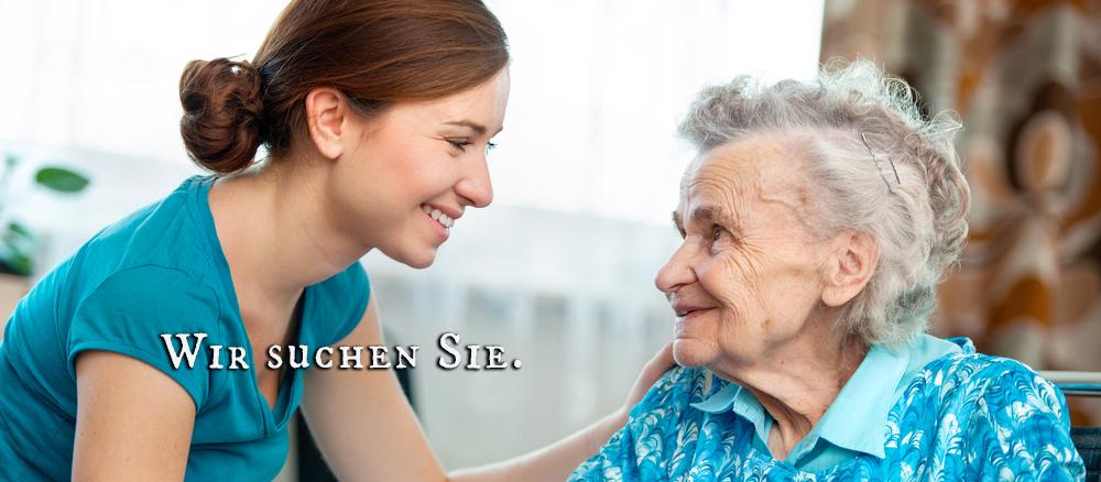 Hand auf Schulter bei alter Frau
